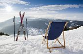 Cross ski and Empty sun-lounger at mountains in winter Czech mountain poster