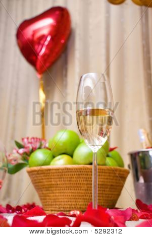 Champagne Glass And Basket With Green Apples