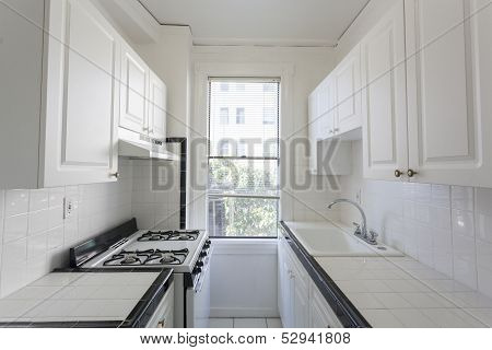 Clean and empty kitchen in an apartment poster