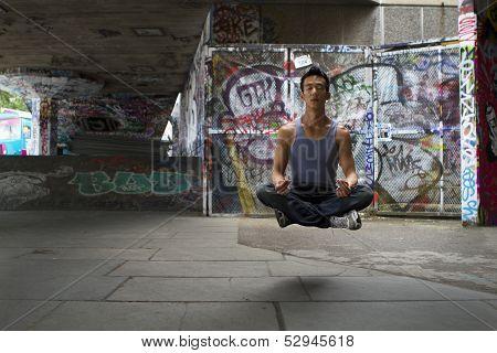 Young man levitating during meditation
