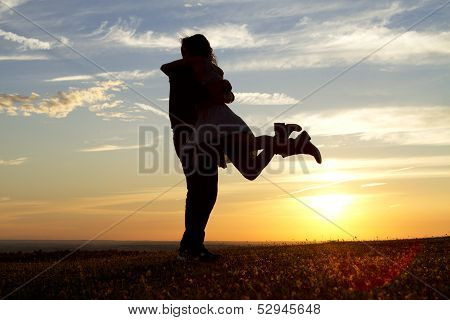 Young couple embracing during sunset