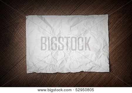 Crumpled Paper On Wooden Background