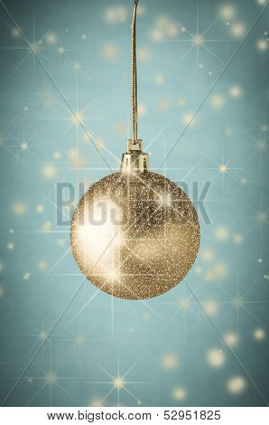Gold Glitter Christmas Bauble On Turqoise With Stars