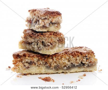 Delicious cake cut in pieces over a white background
