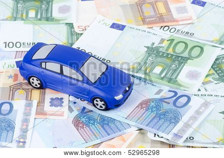 Toy car for euro banknotes  as background