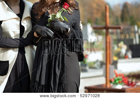 Mother And Daughter At Cemetery