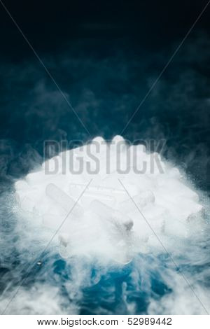 dry ice with vapor on blue background