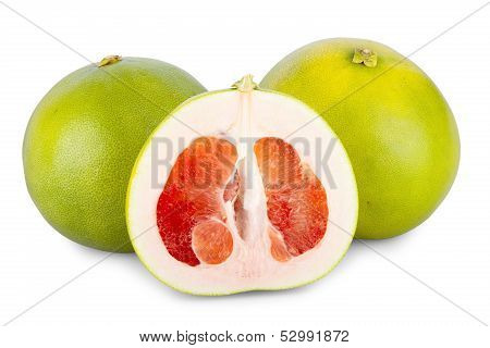 Two Whole And One Halved Pomelo Fruits