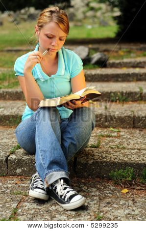 Student Reading In A Public Park