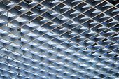 Modern architecture abstract background with metal cellular ceiling poster