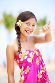 Hawaii beach woman making Hawaiian shaka hand sign. Pretty and free asian girl enjoying vacation holiday on beach resort with palm trees. Mixed race female on Big Island, Hawaii poster