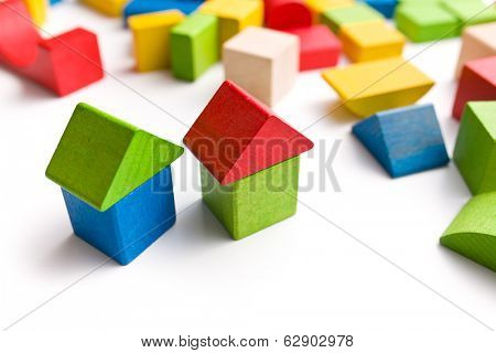 house made from wooden toy blocks on white background