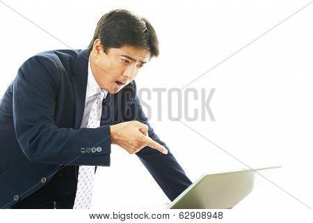 Surprised Asian businessman
