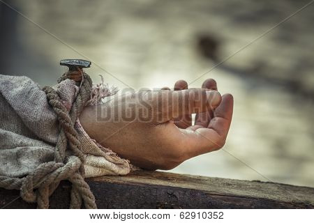Nailed Hand On Wooden Cross