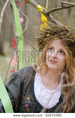 Close Up Portrait Of A Pretty Smiling Girl In A Folk   Circlet Of Flowers