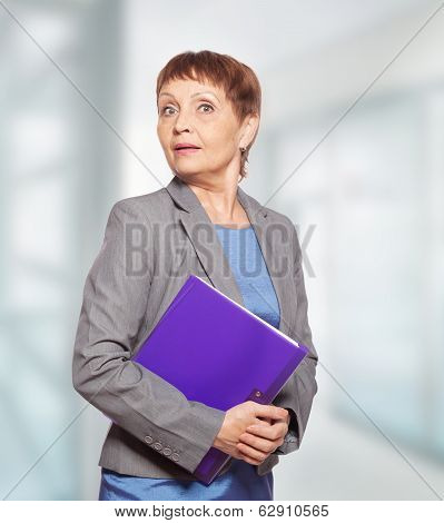 Attractive Woman 50 Years Old With A Folder For Documents
