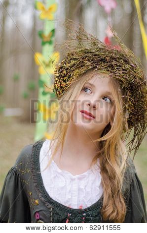 Close Up Portrait Of A Pretty Pensive Girl In The Circlet Of Flowers In A Folk  Medieval Style