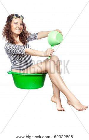 Girl Sitting In A Basin Rides.