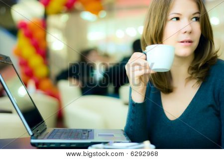 Young Business Woman Drinking Coffee And Working On Computer