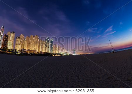 DUBAI, UAE - MARCH 29: Dubai Marina at Dusk from the top, on March 29, 2014, Dubai, UAE. In the city of artificial channel length of 3 kilometers along the Persian Gulf.