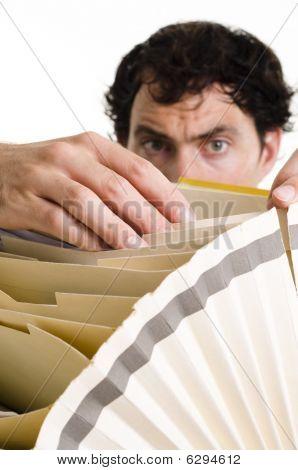 Man Filing Paperwork