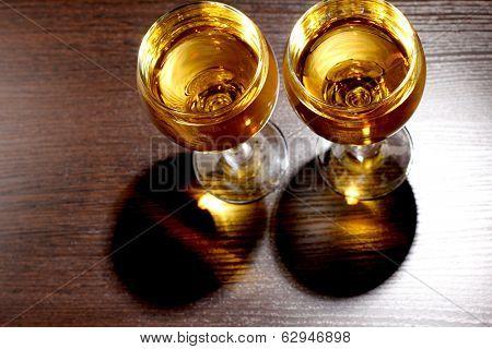 Luxury old whiskey glass on wood background