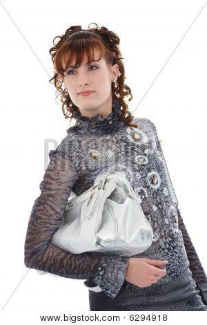 Studio Shot Of Posing Woman With Bag