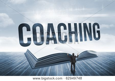 The word coaching and gesturing businessman against open book against sky