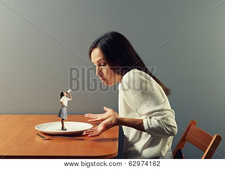 small discontented woman screaming at big businesswoman