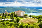 chateau and church in Aiguines and St Croix Lake at background, Var Department, Provence, France poster