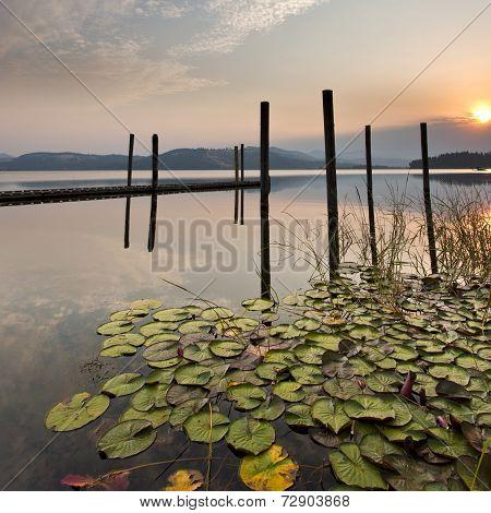 Colorful Sunrise Over Calm Lake.