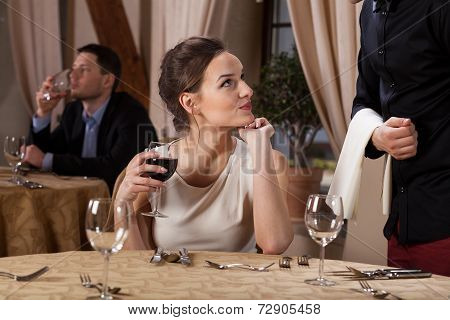 Young Woman Flirting With Waiter