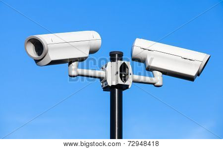 Two Closed-circuit Television Cameras Mounted On Black Pole