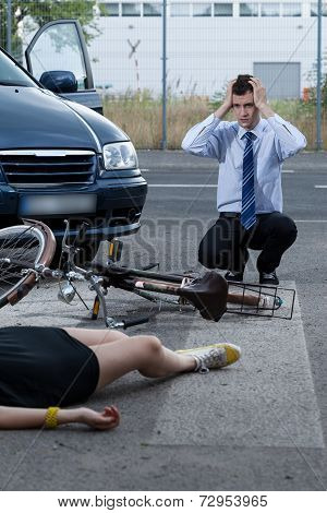 View of woman after accident on bike poster