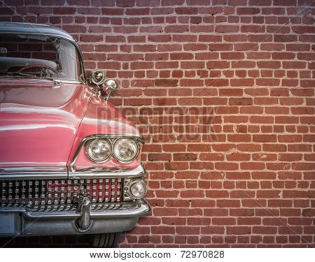 Classic Car Against Red Brick Wall