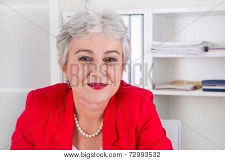 Portrait of happy senior businesswoman