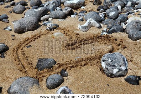 Beach with sand and pebbles, England