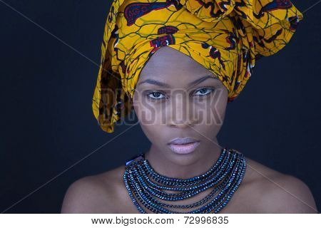 Portrait of a young African woman in traditional dress.