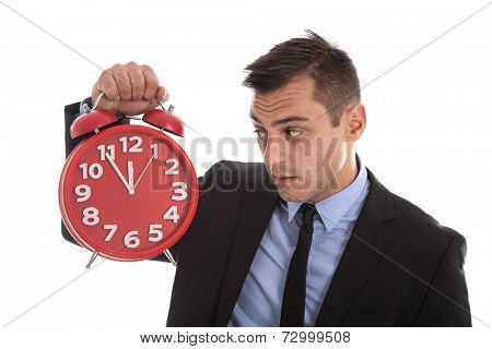 Time is money : businessman holding up red alarm clock isolated on white background