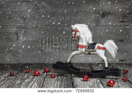 Old wooden horse - shabby chic Christmas decoration - background for a greeting card