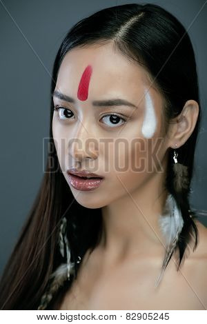beauty young asian girl with make up like Pocahontas, red indian