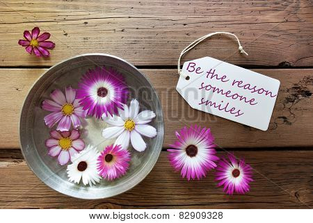 Silver Bowl With Label With Life Quote Be The Reason Someone Smiles With Purple And White Cosmea Blossoms On Wooden Background Vintage Retro Or Rustic Style poster