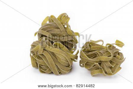 nest of green tagliatelle
