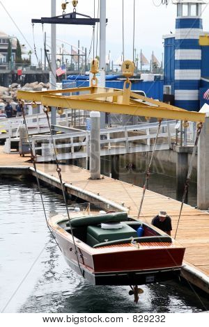 crane handling a boat