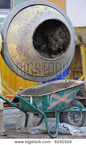 Cement mixer with wheel barrow