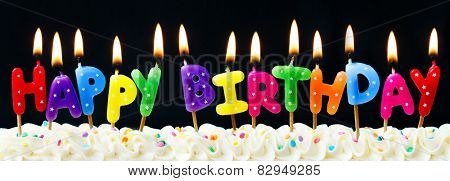 Happy birthday candles against a black background poster
