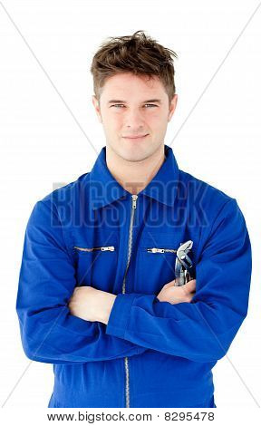 Charismatic Mechanic Holding Tool Smiling At The Camera