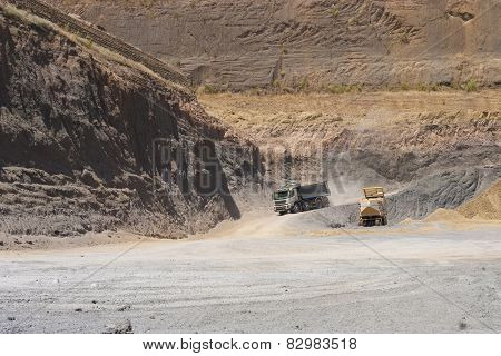 Truck And Bulldozer Work In The Quarry