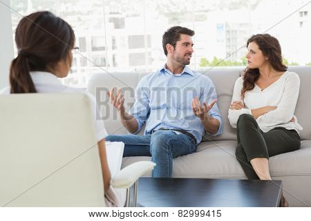 Couple talking with their therapist in the office