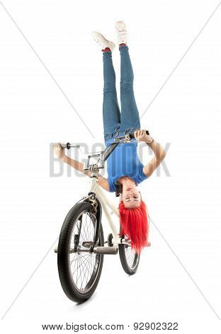 Girl Balancing Upside-down On The Bicycle